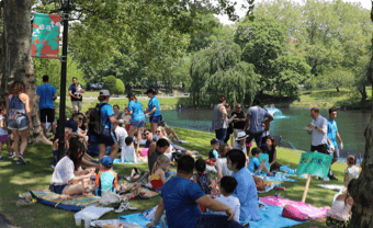 People surrounding the pond at the Poly Summer campus