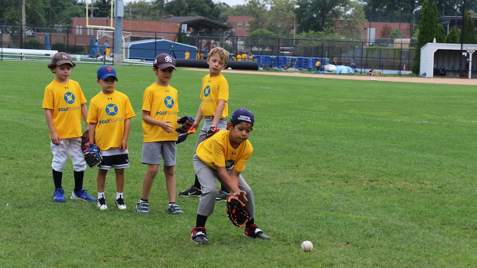 poly summer campers participating in baseball on campus
