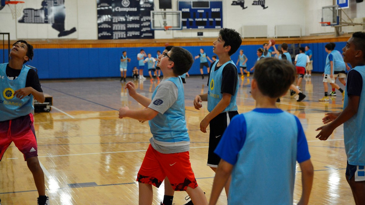 poly summer campers playing basketball