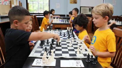 poly summer campers playing chess