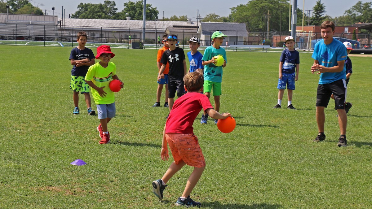 poly summer campers participating in sports on campus