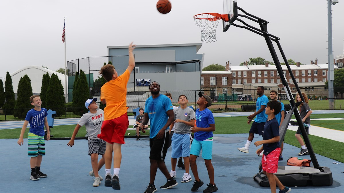 poly summer campers participating in basketball