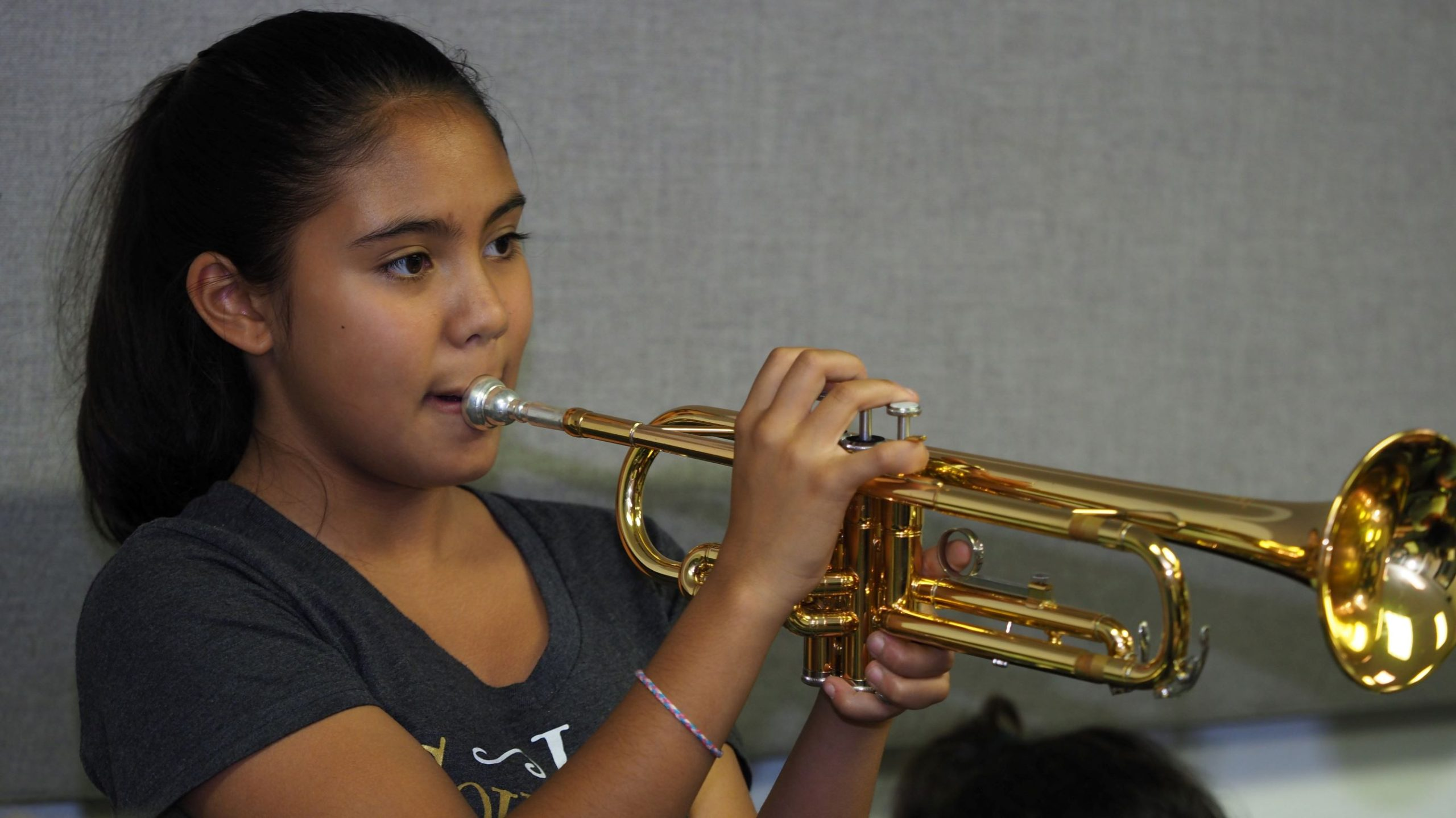 Poly summer camper playing trumpet
