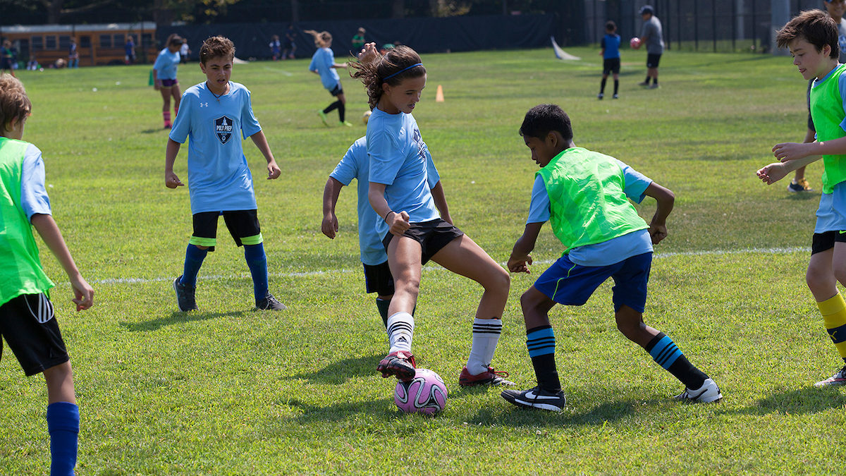 poly summer camp campers playing soccer