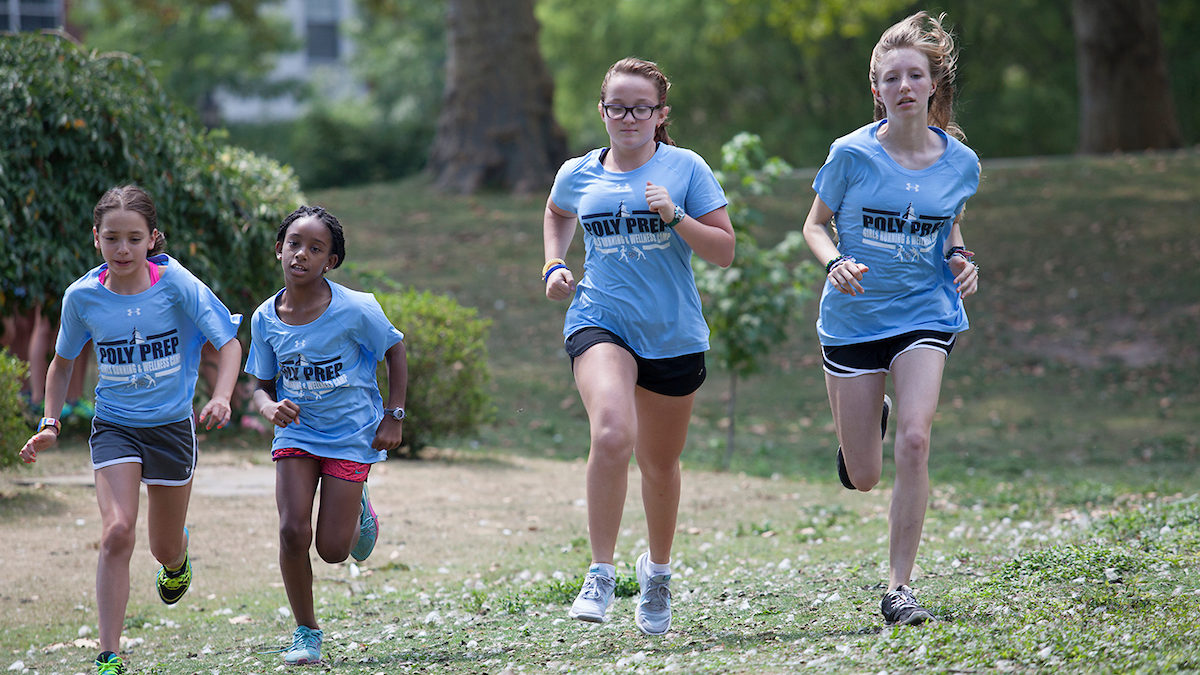 poly summer campers running track on campus