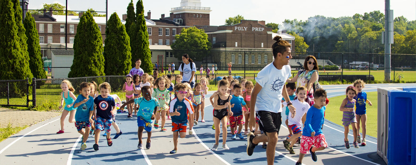Poly Summer campers running on track