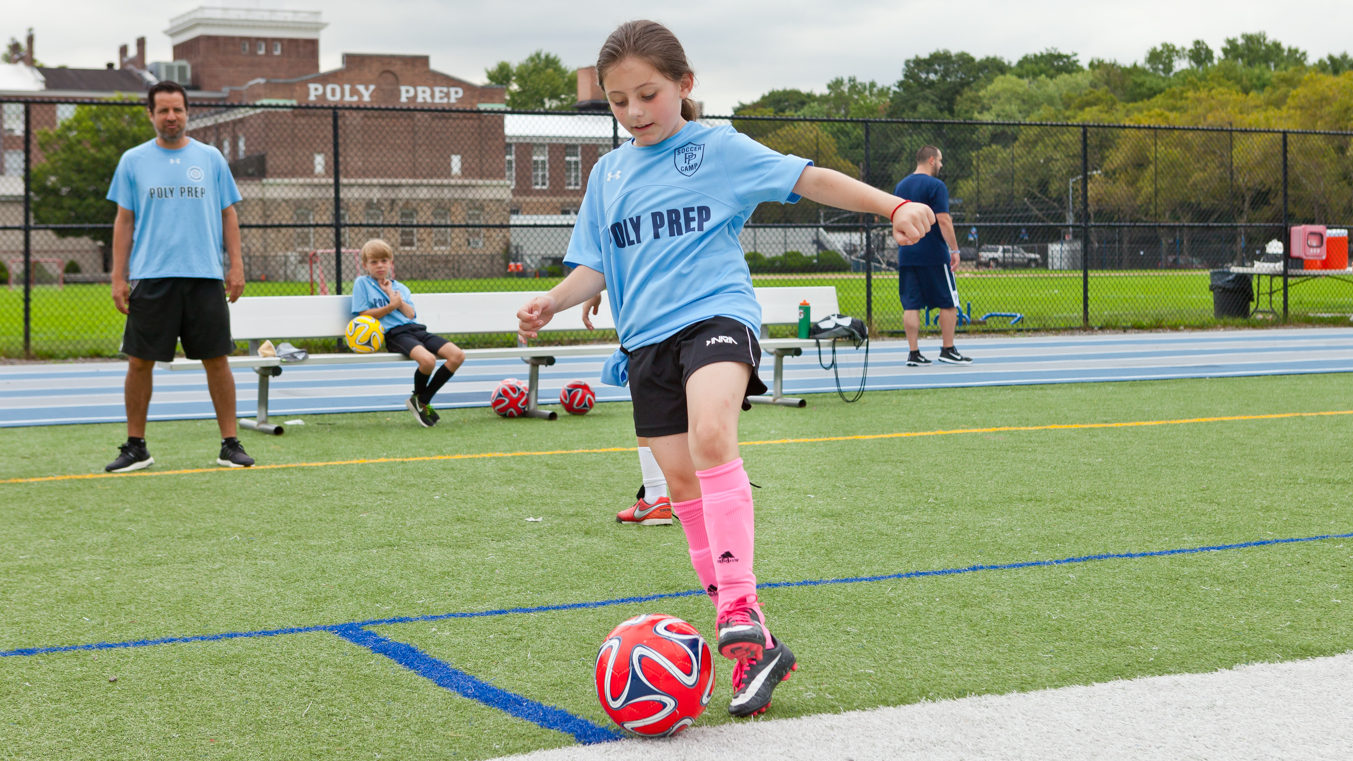 poly summer campers playing soccer